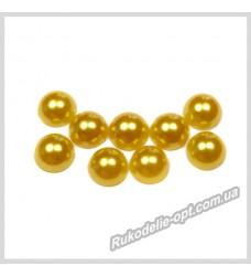 Полубусины акриловые круг золотые 7 мм.