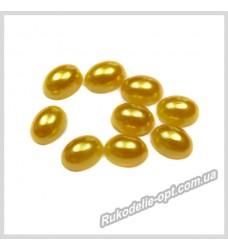 Полубусины из акрила овал золотые 6*8 мм.